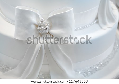 Wedding cake decorated with pearls - stock photo