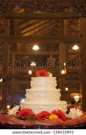Wedding cake in a high end barn reception. - stock photo