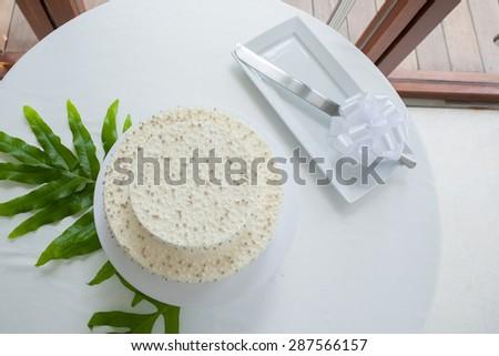Wedding cake set up on table in wedding ceremony - stock photo
