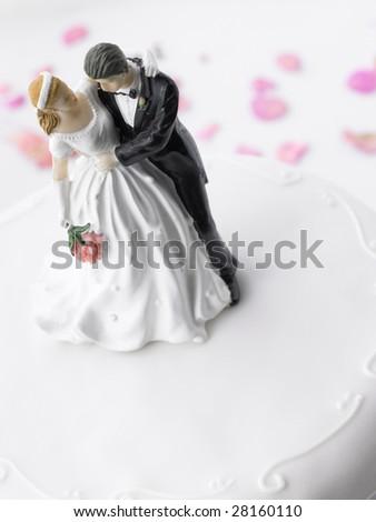 Wedding Cake With Bride And Groom Figurines - stock photo