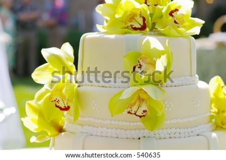 Wedding cake with flowers - stock photo