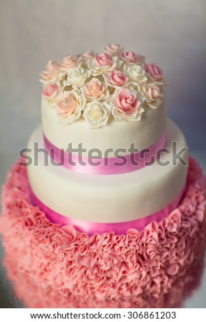 Wedding cake with pink roses - stock photo