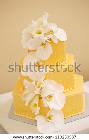 Wedding Cake with White Orchids - stock photo
