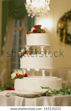 Wedding cake with winter theme holiday decorations  - stock photo