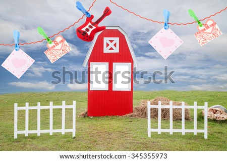 wedding  cards ,hearts and  small guitar  with empty card for your text , on The red house  on a green lawn  trees and white fence ,and beautiful sky and cloud background - stock photo