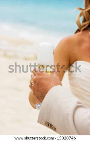 Wedding celebration with champagne on the beach - stock photo