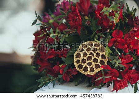 Wedding. Ceremony.Aisle to arch. Marsala floral arrangement of flowers and greenery decorate the arch for the wedding ceremony - stock photo