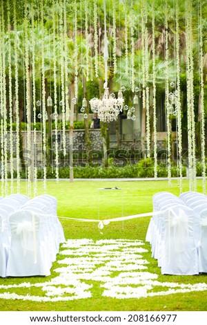 wedding ceremony in a beautiful garden - stock photo