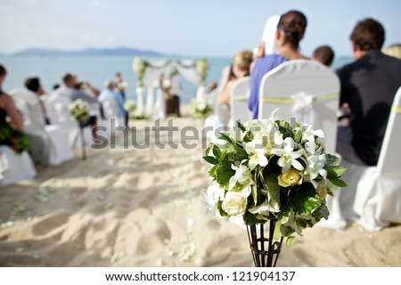 wedding ceremony on the beach - stock photo