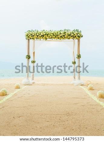 Wedding ceremony on the beach. - stock photo