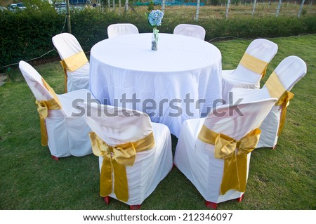 Wedding Chairs and covers at an outdoor wedding - stock photo