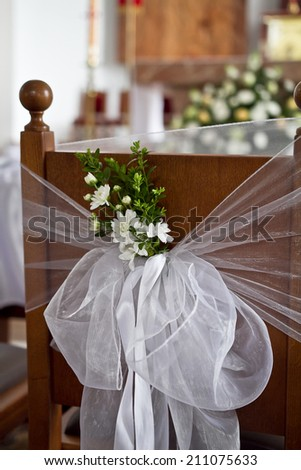 Wedding chairs  decorated with green color and flower.  - stock photo