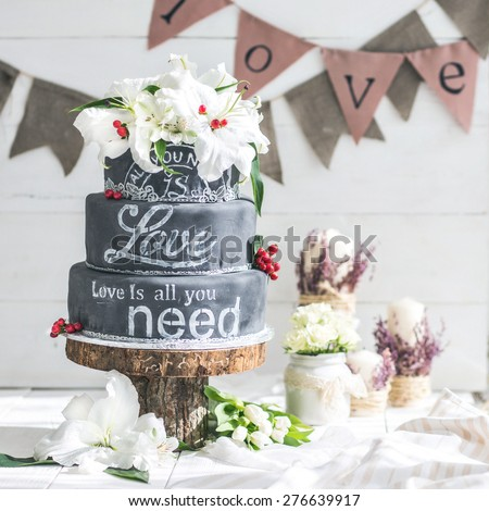 Wedding chalk cake with flowers - stock photo
