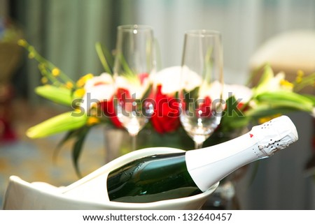 wedding champagne with glass and bouquet in studio shoot. - stock photo