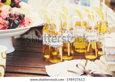Wedding Cocktail with straws for drinking and lemon - stock photo