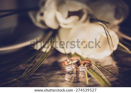 wedding concept - wedding rings and white tulips - stock photo