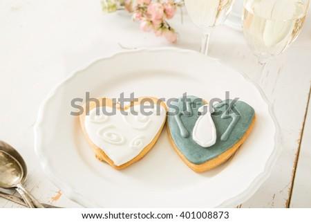 Wedding cookings of bride and groom - stock photo
