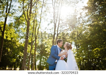wedding couple at forest - stock photo