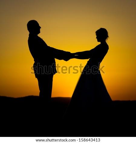 Wedding couple at sunset - stock photo