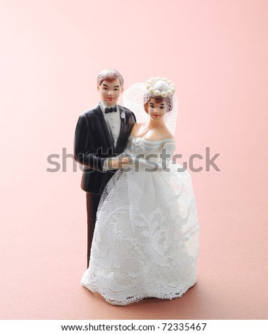 wedding couple doll on pink background - stock photo