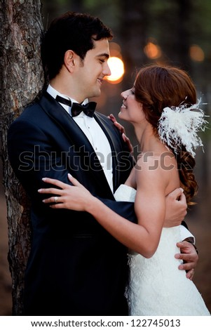 wedding couple happy together at the forest - stock photo