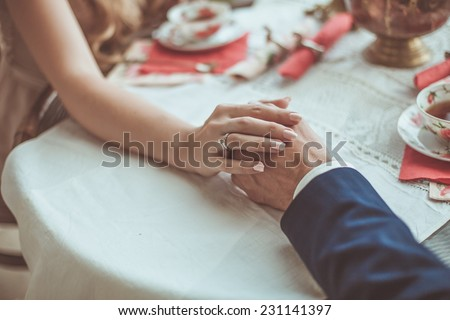 Wedding couple holding hands - stock photo
