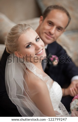 wedding: couple in love bride and groom together in bridal summer day enjoy a moment of happiness and love. Beautiful happy newlywed together. handsome man and alluring woman in white dress smiling - stock photo