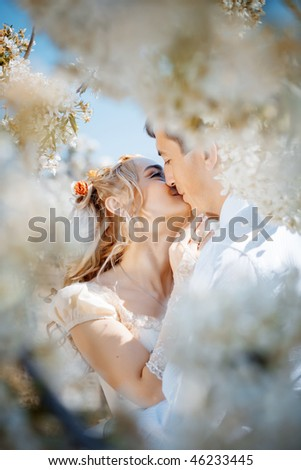 Wedding couple in spring nature - stock photo