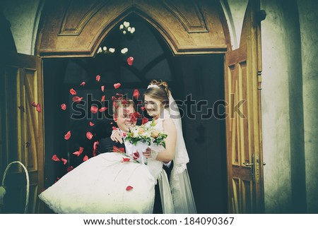 Wedding couple in the Catholic Church - stock photo
