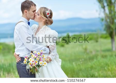 Wedding couple on the nature - stock photo