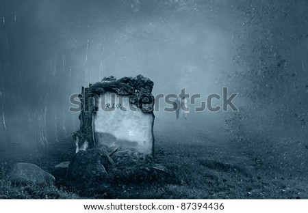 Wedding couple walking away from a grave in a forest - stock photo