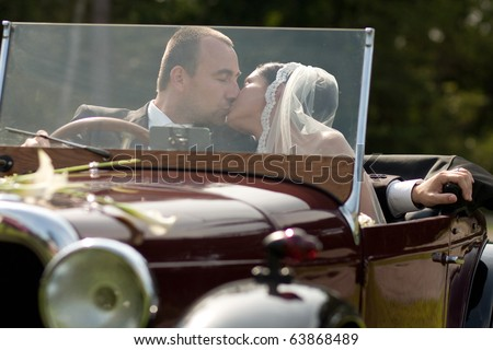 wedding couple with old car - stock photo