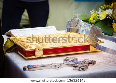 Wedding crowns, cross and bible prepared for ceremony - stock photo