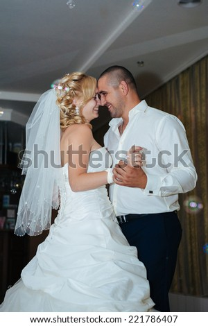 wedding dance of bride and groom. Charming bride and groom on their wedding celebration in a luxurious restaurant. - stock photo