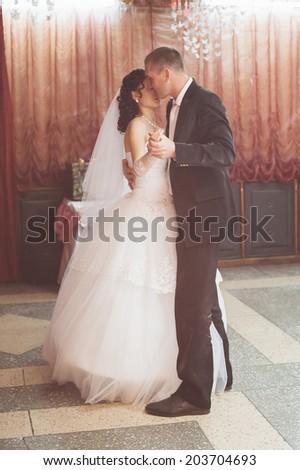 wedding dance of bride and groom, retro filter - stock photo