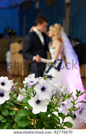Wedding dance the bride and groom, and flowers in the background near - stock photo
