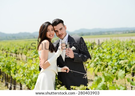 wedding day of cheerful married young couple bride and groom cheering with a cup of champagne - stock photo