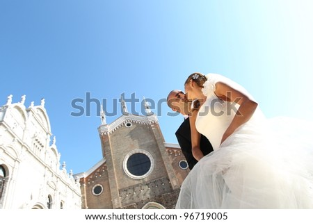 wedding day of young pair isolated on blue sky. - stock photo