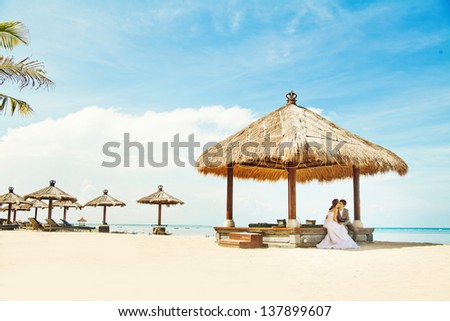wedding day: relaxing in gazebo - stock photo