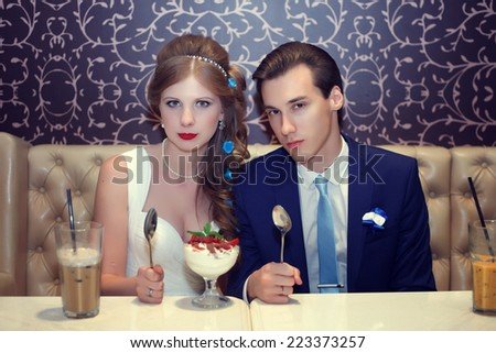 Wedding day. The groom and the bride feed each other - stock photo