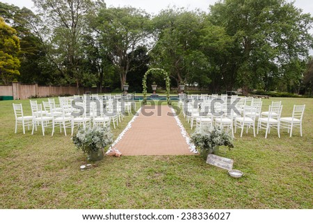 Wedding Decor Home Wedding Decor Home Wedding decor chairs ceremony lawn pool landscape with guests lunch dinner table settings on porch veranda of mansion home. - stock photo