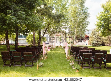 Wedding decoration (arch on the lawn in the park) - stock photo
