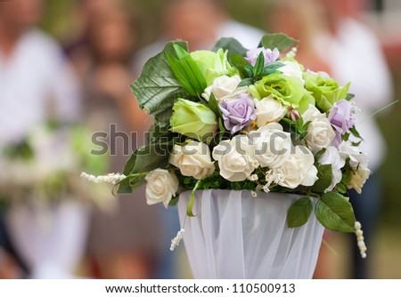 Wedding decoration. Flowers at an outdoor wedding venue - stock photo