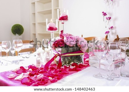 Wedding decoration made of red and pink peonies.  - stock photo