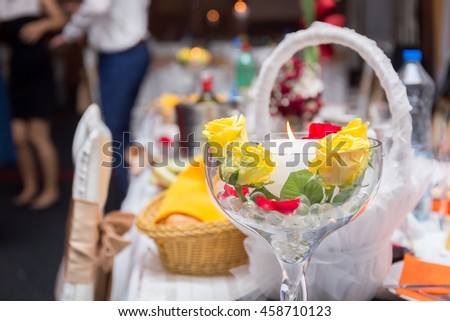 Wedding decoration table with candle in glasses - stock photo
