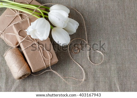 Wedding decoration with craft paper wrapper box and golden rings - stock photo