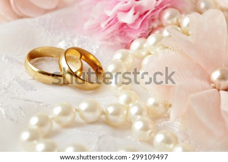 wedding decoration with flowers and wedding rings - stock photo