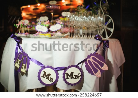wedding dessert with delicious cakes and macaroons - stock photo