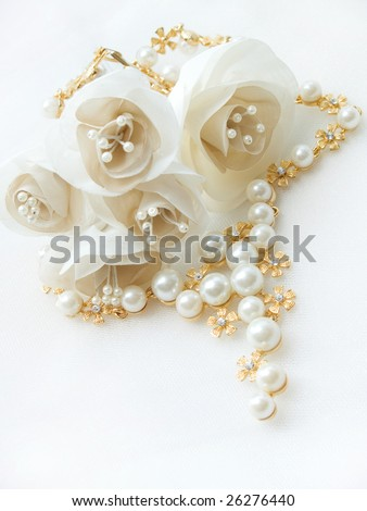 Wedding details. artificial flowers and jewelry - stock photo