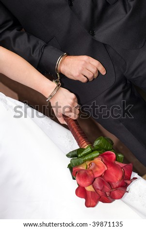 wedding details - newlyweds in handcuffs - stock photo